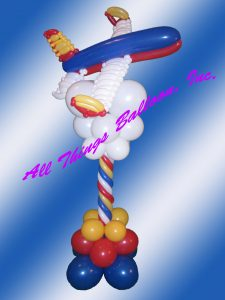 balloon decorator - balloon column - balloon version of Southwest Airline plane above balloon clouds