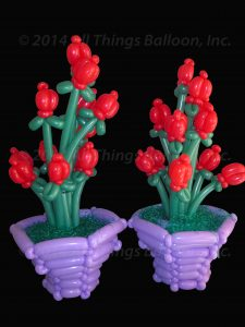 balloon artist - balloon flowers in balloon vase